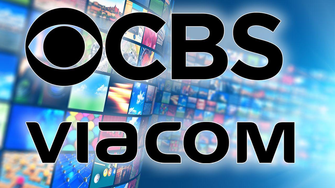 CBS e Viacom, scritte. Sullo sfondo schermi televisivi